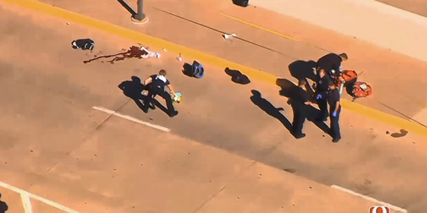 This still image taken from an aerial video provided by KWTV shows police responding to a shooting at Will Rogers World Airport in Oklahoma City. Photo / AP
