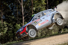 Hyundai motorsport's Hayden Paddon of New Zealand is airborne during a Rally Australia time trial. Photo / AP
