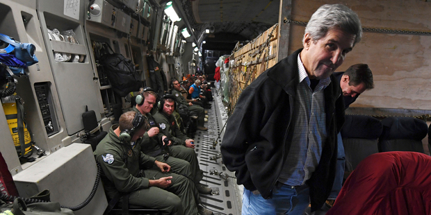U.S. Secretary of State John Kerry smiles onboard a U.S. Air Force C-17 Globemaster that was heading to the McMurdo Station, Antarctica Saturday, Nov. 12, 2016. Kerry became the highest-ranking Americ