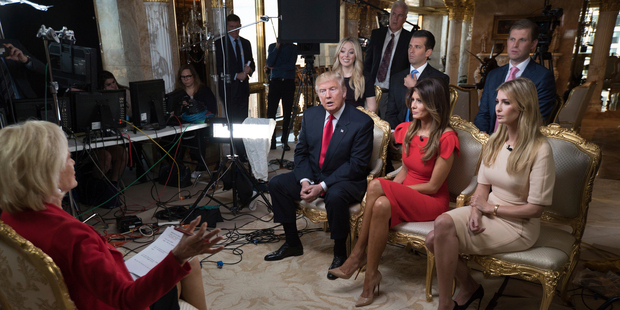 Loading President-elect Donald Trump and his family gather for 60 MINUTES interview. Photo / AP
