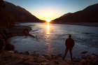 Sunset at Haast River. Tourists are heading to the South Island's West Coast in their droves after the devastating east coast earthquake. Photo / Mark Mitchell.