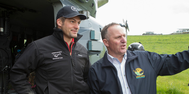 Prime Minister John Key with former All Black captain Richie McCaw during his visit to Kaikoura. Photo / Mark Mitchell. R
