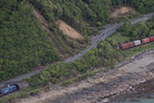 A freight train sitting where it came to a halt after Monday's earthquake beside State Highway 1, north of Kaikoura, was looted on Wednesday. Photo / Mark Mitchell