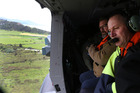 Prime Minister John Key viewing earthquake damage north of Kaikoura from an RNZAF helicopter.  Photo / Mark Mitchell