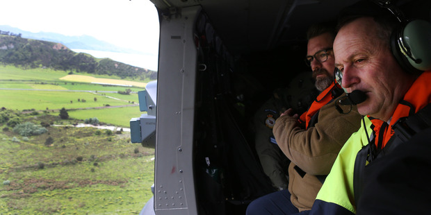 Loading Prime Minister John Key viewing earthquake damage north of Kaikoura from an RNZAF helicopter. Photo / Mark Mitchell