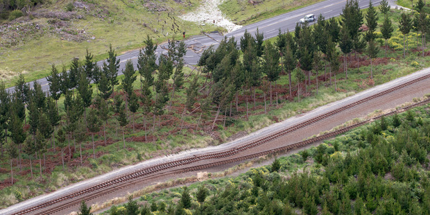 Earthquake damage on State Highway One and the main trunk railway line north of Kaikoura. Photo / Mark Mitchell
