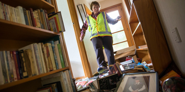 Waiau School principal Mary Kimber amongst the devastation in the school house where she lives. Dannevirke's Chloe Turton teaches at the school. Photo / NZME