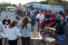 Tourists, locals and volunteers line up for dinner at the Takahanga Marae in Kaikoura. Photo /  Mike Scott