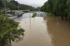 Block Road is swallowed up by the Hutt River on Tuesday during heavy rain - which is due to hit again tonight and tomorrow. Photo / Melissa Nightingale