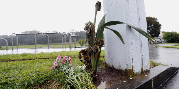 Flax and flowers mark the spot on William Jones Drive in Otangarei after the fatal shooting of Moses Noor Mahanga, aged 25 of Whangarei. Photo / Northern Advocate