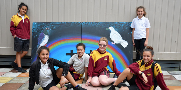 Kaikohe Christian School students Sativa Rogers, Puti Clarke, Tracey Schuetze, Simon Mulder, Awatea Watene and Otiria Harrington with their completed art work, in two pieces, which will be hung with pride on either side of the school stage. Photo / Debbie Beadle