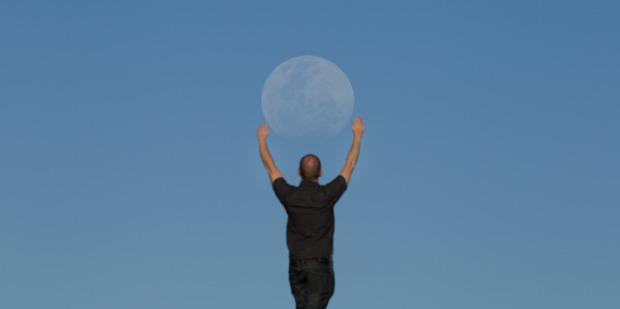 Chris Pegman has the supermoon in his hands. PHOTO/ Chris Pegman