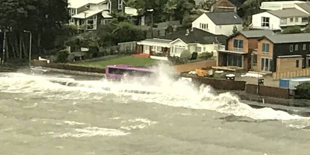 High tide and winds in Lowry Bay. Photo / Facebook