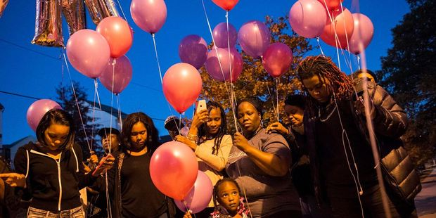Family members and friends gather in November in Northeast Washington for a prayer and balloon release in remembrance of LaKira's twin daughters. Photo: Nikki Kahn, The Washington Post.