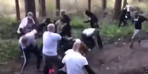 Two sets of ultras square up to each other in a remote woodland area on the outskirts of Rotterdam. Photo / YouTube.
