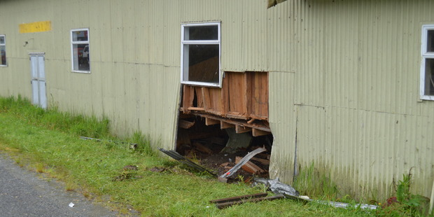 The hole in the side of the Ngahere Hall, where the car became wedged under the stage. Photo / Greymouth Star