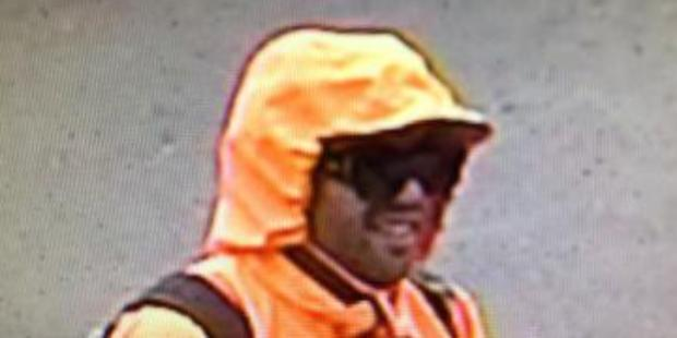 Auckland Police are on the hunt for two high-vis wearing offenders who tried to rob a Penrose shop with a handgun.