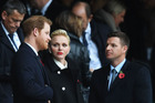 Prince Harry (L) and Princess Charlene of Monaco (C) are seen in the stand prior to the Old Mutual Wealth Series match between England and South Africa. Photo / Getty Images