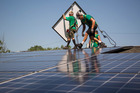 SolarCity Corp. employees install solar panels on the roof of a home in Kendall Park, New Jersey, U.S. Photo / Bloomberg