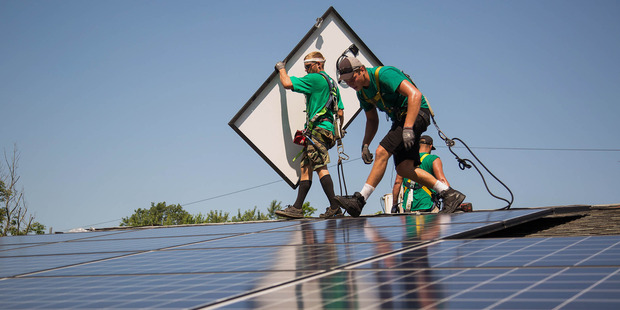Loading SolarCity Corp. employees install solar panels on the roof of a home in Kendall Park, New Jersey, U.S. Photo / Bloomberg