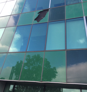 A photo of damage to Statistics House from the exterior.