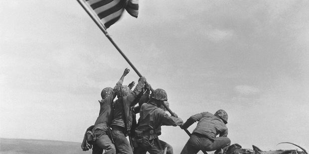 The 1945 flag raising at Iwo Jima by the AP's Joe Rosenthal is included in Time magazine's most influential images of all time. Photo / AP