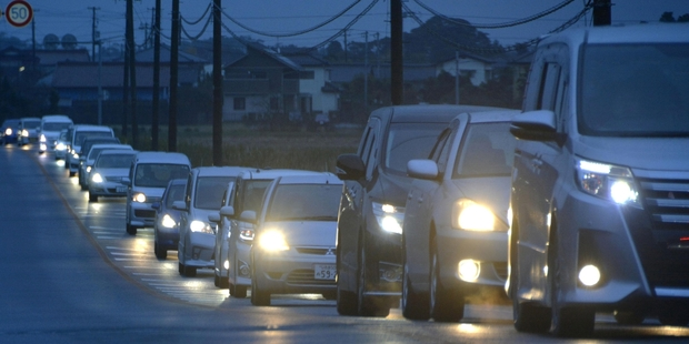 Loading Fukushima prefecture residents make their way to higher ground. Photo / AP