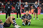 Shaun Johnson and his Kiwis teammates look dejected on the Anfield turf following their 34-8 defeat to the Kangaroos in the Four Nations final in Liverpool. Photo / Photosport