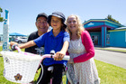 Tallica-Rose Buchannan, 6, with Tommy Wilson and Merivale Primary School principal Jan Tinetti. Photo/Ruth Keber