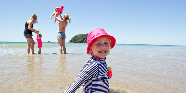Lucy Evemy, 4, at Mount Maunganui Beach with mum Courtney Evemy and Olive, 1, and Rebecca Thomson and Ruby Rankin, 1. Photo/Ruth Keber