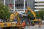 Demolition work underway on the shopping annex attached to the nine-storey building at 61 Molesworth Street in Wellington.  24 November 2016. New Zealand Herald photograph by Mark Mitchell