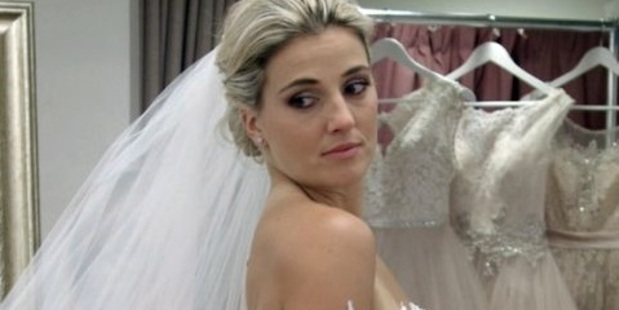 Gemma Flynn trys on a wedding dress on the Australian reality TV show Say Yes to the Dress