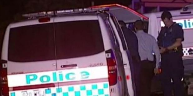 Police at the double stabbing at Alexandra Hills, Brisbane. Photo / Channel 9