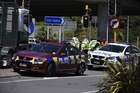 Emergency services attend the fatal accident near the Tauranga Harbour Bridge yesterday. Photo / George Novak