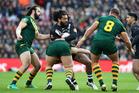 New Zealand's Adam Blair, centre, in action with Australia's Aaron Woods, left, and Matthew Scott, right. Photo / AP