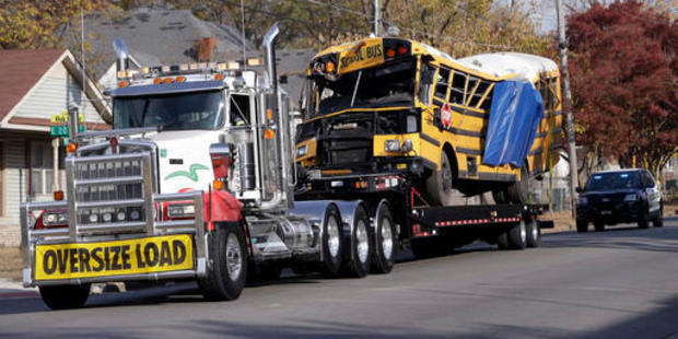 The school bus is carried away from the site where it crashed in Chattanooga, Tennessee. Photo / AP