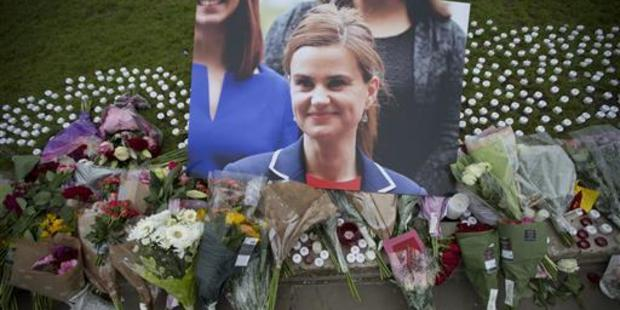 Floral tributes lie outside Parliament House in London for murdered British MP Jo Cox. Thomas Muir has been convicted of killing her. Photo / AP