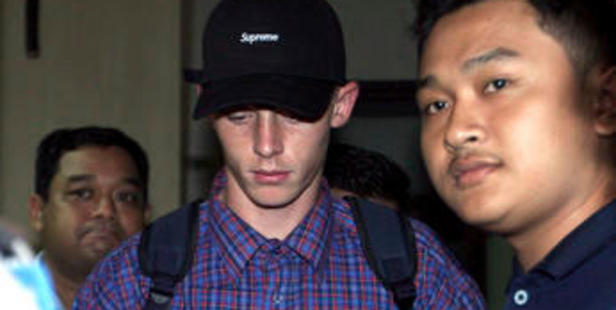 Australian Jamie Murphy is escorted by plain-clothed police officers upon his release from police custody in Bali. Photo / AP