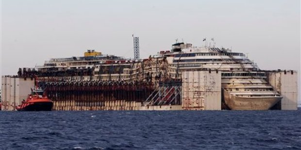 The salvaging of the Costa Concordia cruise ship took two years and a considerable amount of money. It is towed by tugboats towards Genoa's harbour in July 27, 2014. Photo / AP
