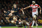 Wales James King is tackled by Japan's Timothy Lafaele. Photo / AP