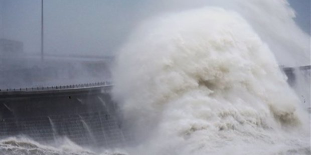 Waves crash over the harbour wall in Dover, south east England, as a storm, Storm Angus, the year's first big winter storm in Europe, lashes England's south coast. Photo / AP