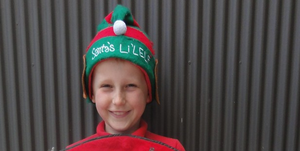 Brock Harlum of earthquake-struck Rangiora has won the opportunity to sit with Santa on his sleigh at this years Christmas Parade.