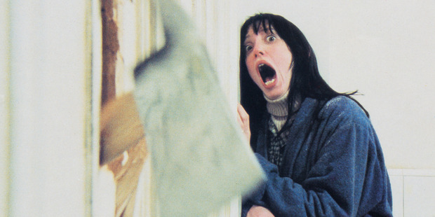 Wendy Torrance, played by American actress Shelley Duvall, recoils in shock as her husband chops through the bathroom door with a fire axe in a scene from 'The Shining.' Photo / Getty