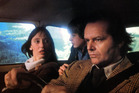 Shelley Duvall, Danny Lloyd, and Jack Nicholson in car on their way to resort in lobby card for the film 'The Shining', 1980. Photo / Getty