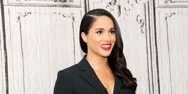 Meghan Markle swings between humanitarian work and Hollywood events and has penned an open letter for Elle Magazine expressing the challenges it brings. Photo / Getty.