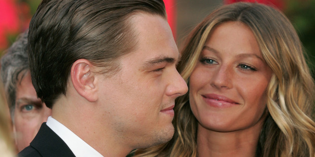 Actor Leonardo DiCaprio and Gisele Bundchen arrives at the 77th Annual Academy Awards. Photo / Getty