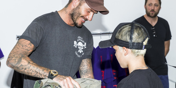 David Beckham and son Cruz David Beckham at the Kanye West temporary PABLO store at on August 19, 2016. Photo / Getty