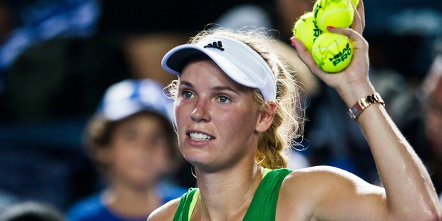 Caroline Wozniacki celebrates after winning at the WTA Prudential Hong Kong Tennis Open. Photo / Getty Images