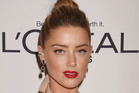 Amber Heard, seen here at the Women of the Year awards last week, is facing legal action for not appearing naked in a movie. Photo/Getty
