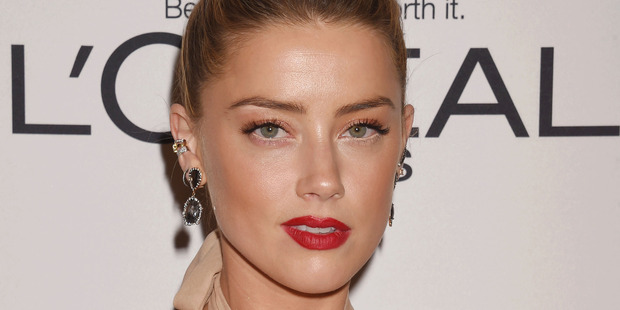 Amber Heard sued for $10m over 'conspiracy' in London Fields promotion class=